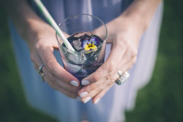 Violets are the bride's favorite flower from childhood and while they didn't end up in her arrangements, she served Parma Violet signature cocktails complete with a fresh bloom in every glass.