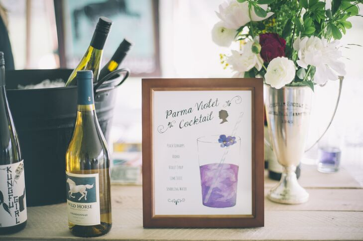 Most of the wedding decor was handmade by the bride including the food and drink signs, chair backers and wedding programs which were a mix of hand painting andrnprint.