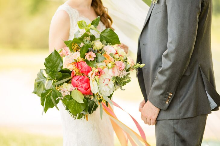 """Mollie's bouquet was a large arrangement of peonies in bright pink and a selection of blush and pink softer florals surrounded by a bed of large, leafy greens. """"I'm obsessed with flowers, so my flowers were really important to me,"""" she says. """"For my bouquet, I knew I wanted it to be big and more organic in shape."""""""