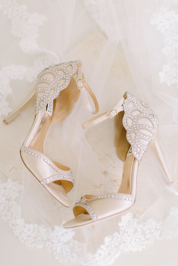 To complete her whimsical bridal look, Stefanie stepped into a pair of champagne Badgley Mischka heels, dressed to the nines with shimmery beadwork in a scalloped design and dainty ankle straps.