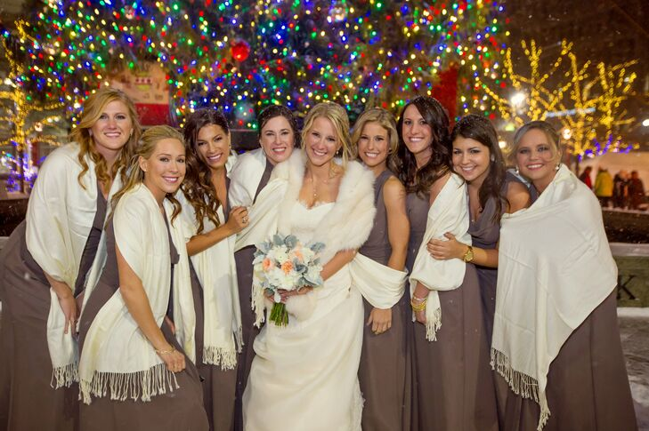 Michelle's bridesmaids paired their taupe, sleeveless, floor-length dresses by Jim Hjelm Occasions with cream wraps.