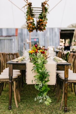 Rustic Tented Reception with Lush Garland Runner