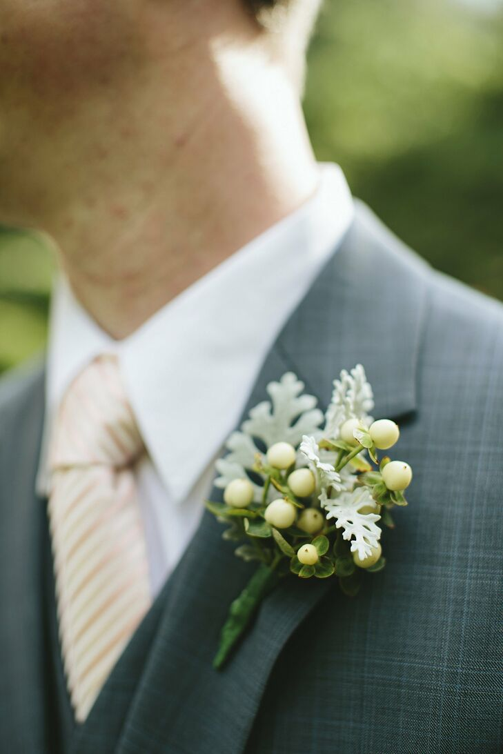 The men's boutonnieres were a masculine combination of hypericum berries and dusty miller.