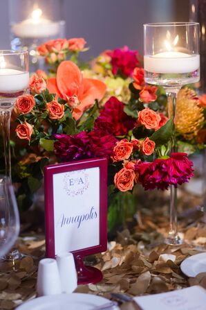 Bright Centerpiece of Fuchsia Dahlias and Orange Carnations
