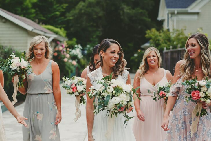Amanda Connors from florist Design in Bloom paired white and blush garden roses with greenery for Crystal and her bridesmaids, who wore dresses in varying shades of blush, gray and ivory.