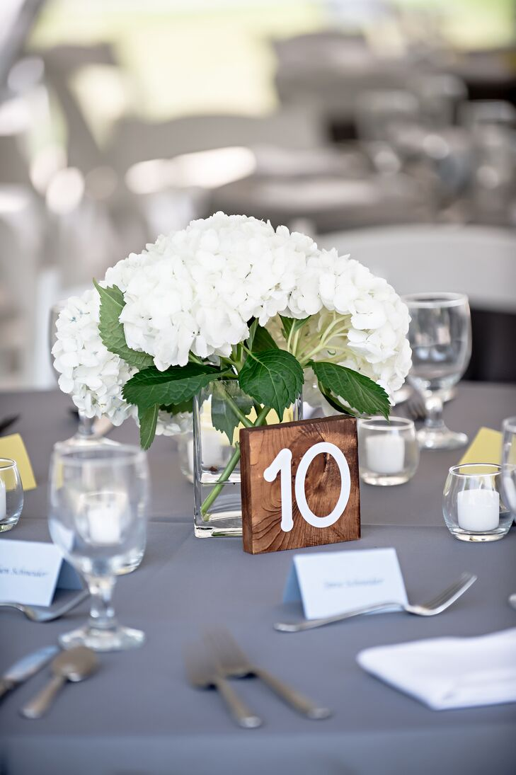 White Hydrangea Centerpieces with Wood Table Numbers