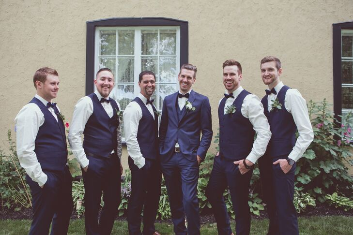 Michael sported a classic navy tuxedo, and groomsmen wore complementary navy pants and vests.