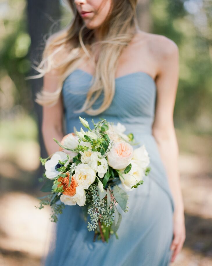 The bridesmaids wore slate blue Jenny Yoo dresses and carried wildflower-inspired bouquets.