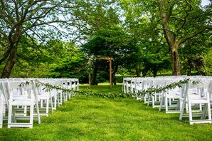 Classic Outdoor Ceremony Site with Wedding Arch and White Folding Chairs
