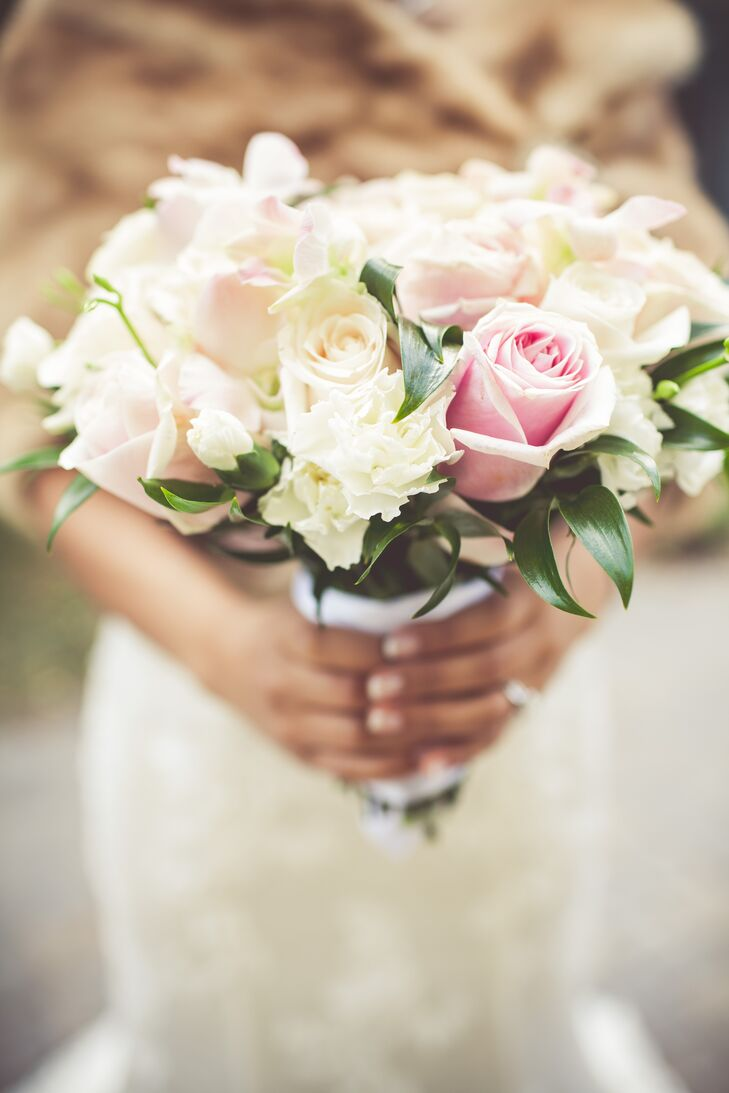 Anne-Maly Pen carried a soft, romantic bridal bouquet with pink and cream roses.