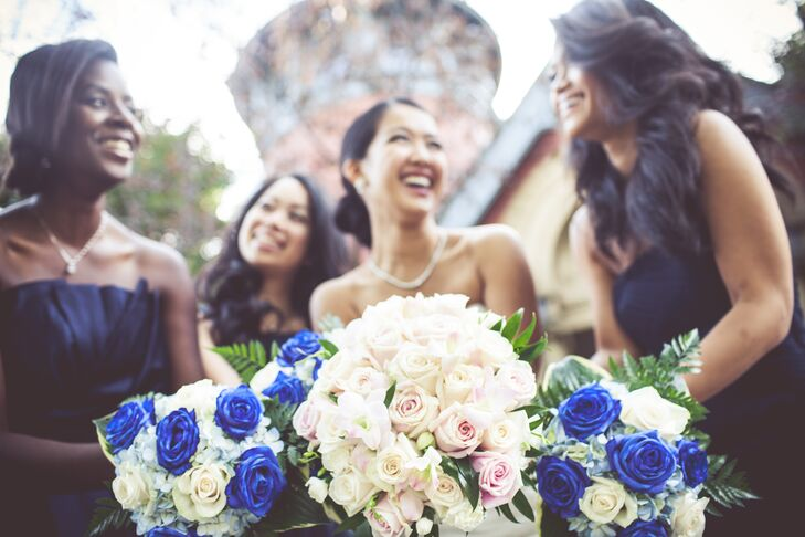 The bridesmaids carried white rose bouquets offset by bright blue roses.