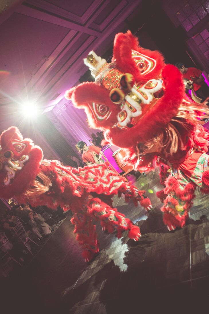 The couple's lively reception had a traditional Cambodian red dragon dance.