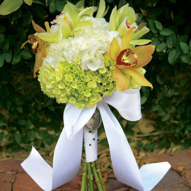 Amber carried a bouquet of orange and green orchids mixed with green and white hydrangeas.