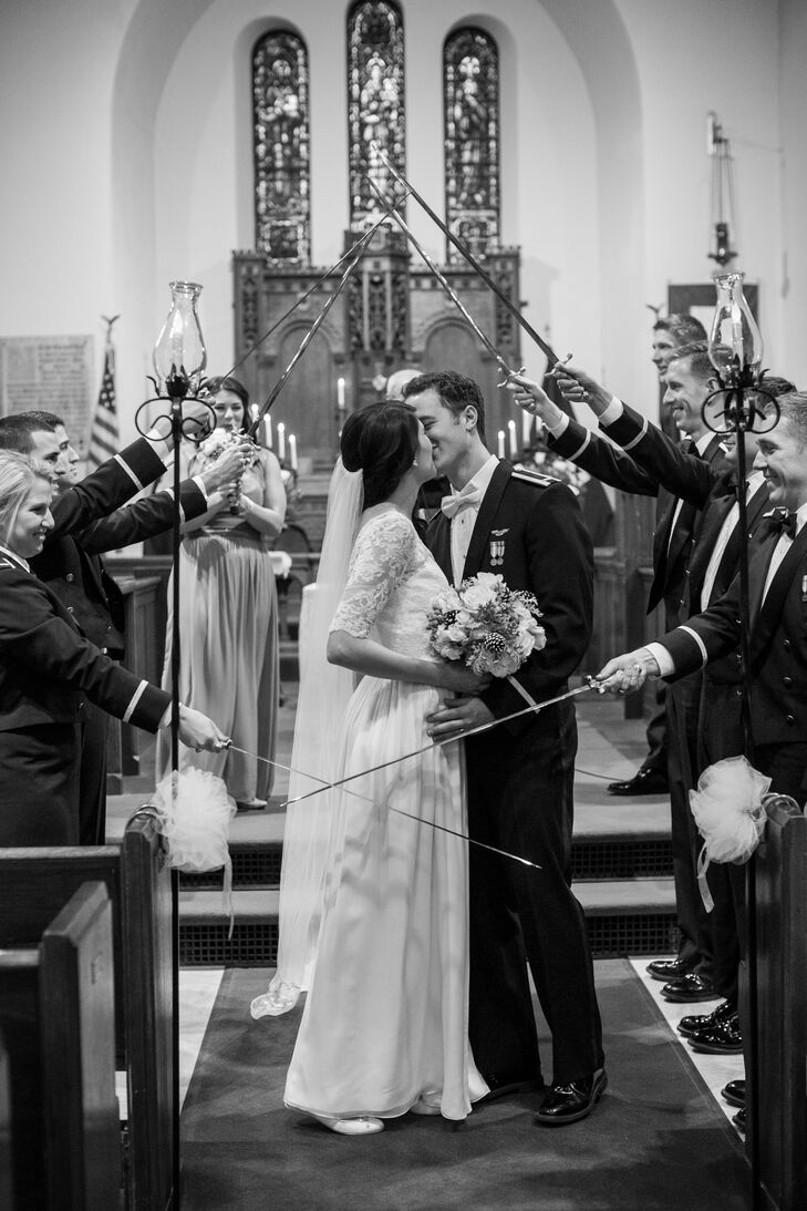 As Matthew is a pilot for the Air Force, it was important to the couple to incorporate several military traditions into the day. After Amy and Matthew exchanged vows in a traditional ceremony at Fort Snelling Memorial Chapel, Matthew's groomsmen followed military tradition and formed and Arch of Sabers for the newlyweds to walk under as they made their exit from the ceremony.