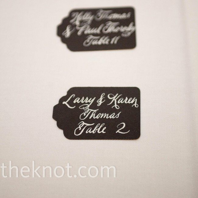 Guests were directed to their tables by black cardstock tags with their name and table assignment handwritten in calligraphy.