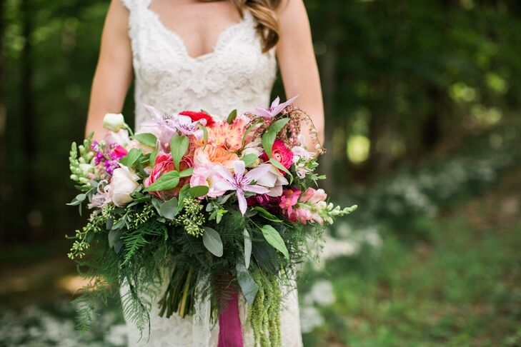 "From the bouquets to the bountiful centerpieces, a close family friend created all the colorful floral arrangements for Samantha and Myles's wedding day. ""The first time I cried on my wedding day was when she walked in with my bouquet—it was exactly what I wanted,"" Samantha says. Filled with garden roses, dahlias, orchids, ranunculus and a vibrant mix of greenery, the arrangement exuded a sense of wild romance."