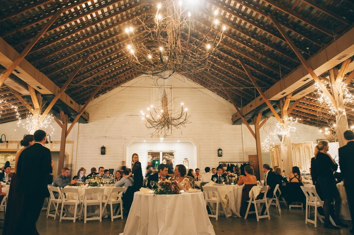 After a romantic proposal at Fearrington Village in Pittsboro, North Carolina, Kara and Pat knew they wanted to get married in the same place. They chose the barn for its rustic flair, which lent itself to the bold, fall color palette.