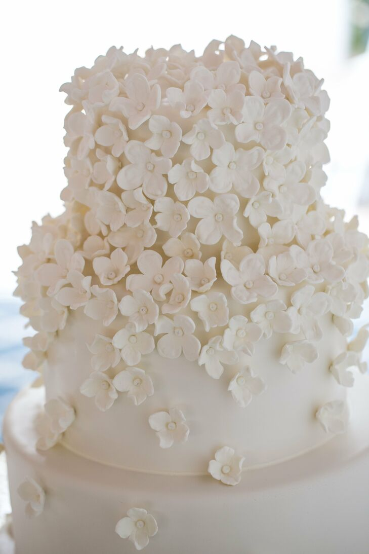Kelly and Michael's white wedding cake reflected the day's decor—it was covered with delicate white blossoms.