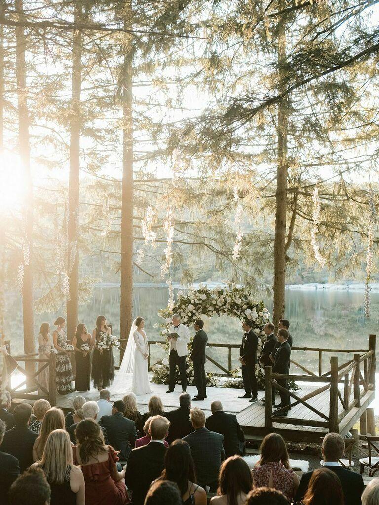Elegant waterfront vow ceremony at outdoor summer wedding