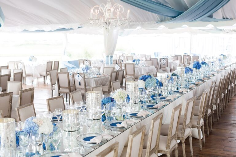 Outdoor Wedding Reception Tables With Blue Hydrangea Centerpieces And Mercury Glass Vases