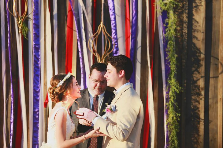 Before a backdrop of bright, beautiful ribbons, Madelyn and Ryan exchanged vows they'd written themselves, expressing their commitment to each other in words that felt true to their relationship. Elements like a short sermon and prayers gave the proceedings a slightly traditional feel, while a sand ceremony, which the couple used to close the ceremony, offered the couple a way to put their own twist on tradition.