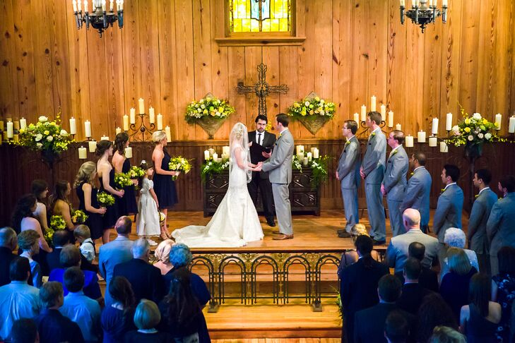 A chapel on the property set a country rustic vibe for the wedding ceremony. The altar was covered in ivory and green candles, a cast iron cross and cascading greenery.