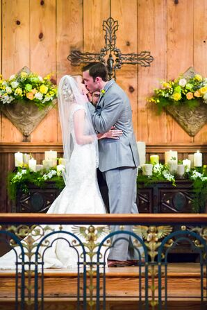 Wedding Kiss in a Rustic Chapel