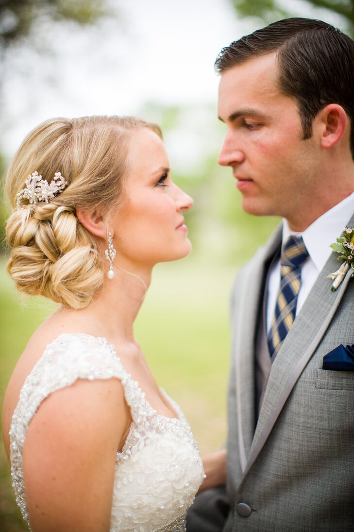 The bride kept her makeup and hair classic to match the timeless style of her wedding dress. She wore a side-swept undo and paired it with a crystal hair clip.
