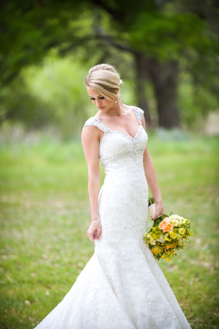The bride wore an ivory fit-and-flare lace wedding dress covered in beads, pearls and crystals. Lacy paired the classic gown with a scalloped veil with beading.