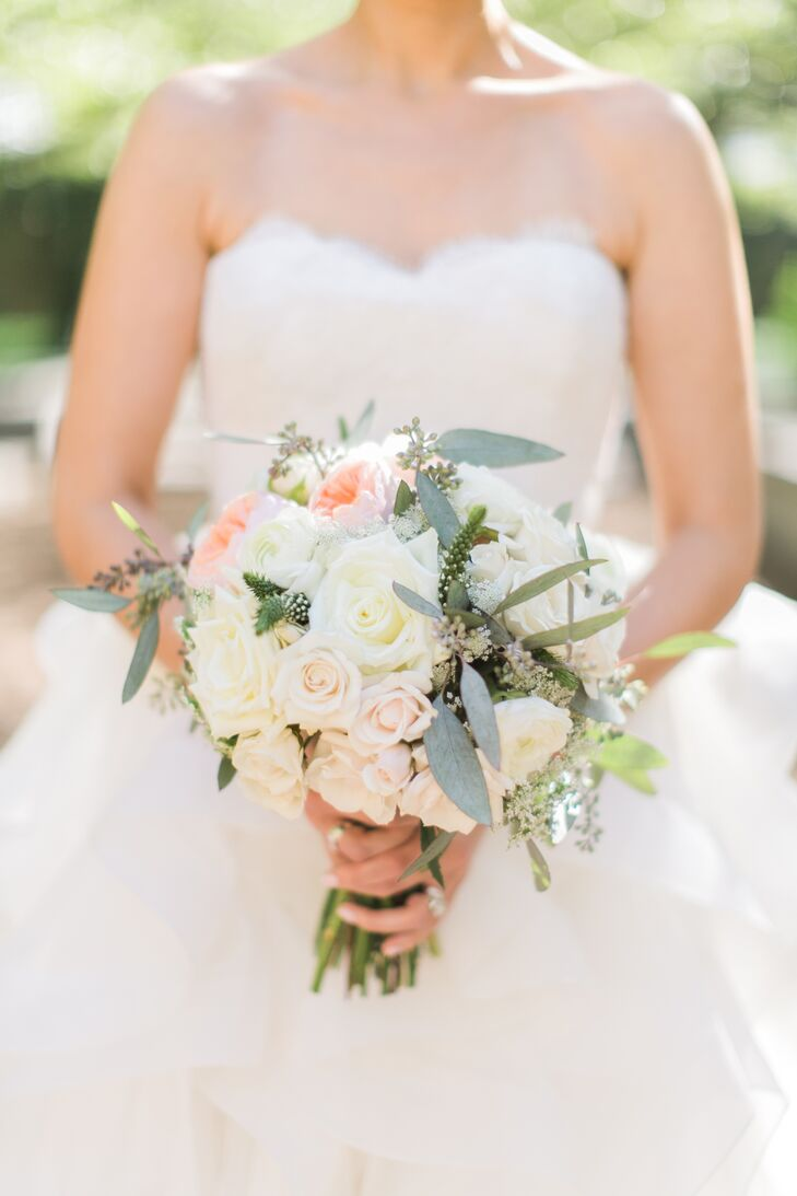 Jessica carried a white and pastel pink rose and garden rose bouquet, offset by eucalyptus leaves.