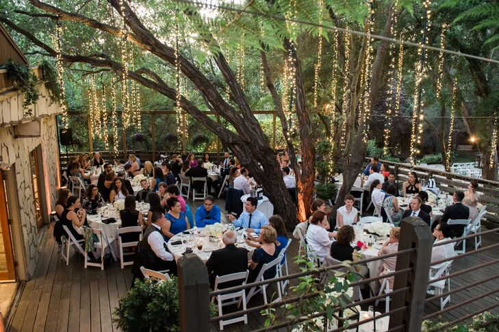 Strings of lights were draped from the oak trees that surrounded the Birchwood Room's outdoor deck, where guests enjoyed dinner after the ceremony.