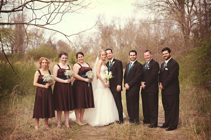 The groomsmen's teal vests popped against the bridesmaids' brown dresses and baby's breath bouquets.