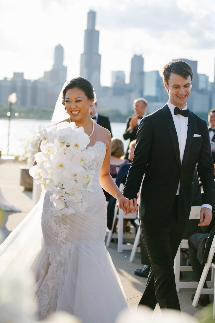 Karen Tye (29 and a resident physician) and David Palm (28 and a consultant) planned a formal lakefront affair using navy and gold accents paired with