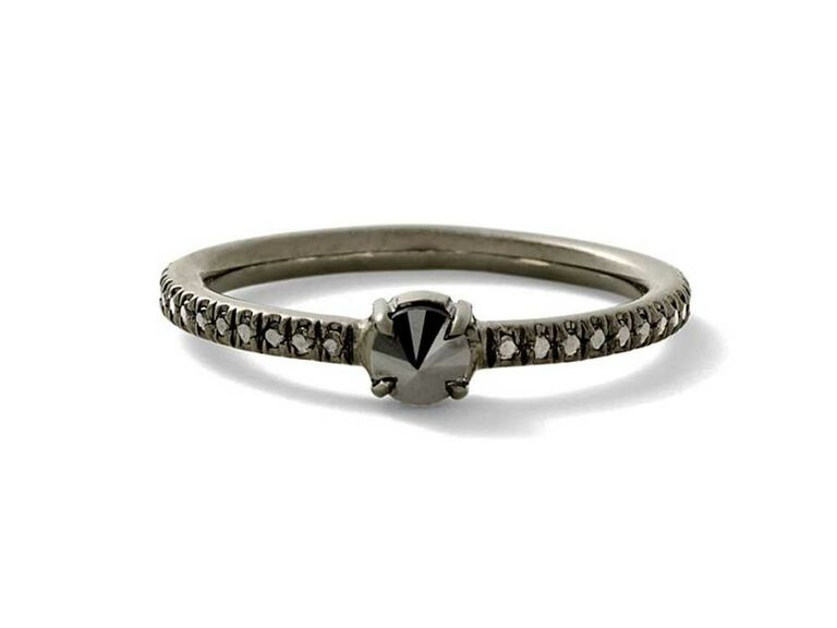 Black diamond engagement ring with pavé diamond band