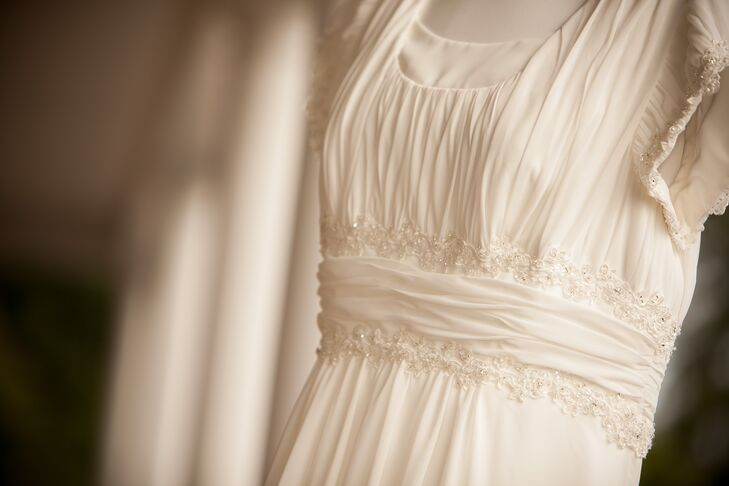 """""""I really wanted a modest look and David's Bridal worked amazingly with us to customize the dress,"""" says Christina. """"The dress is a short-sleeved chiffon soft A-line dress."""""""