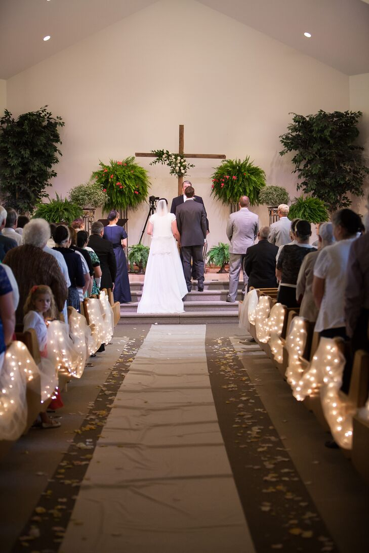 Couple at Ceremonial Altar with Wooden Cross
