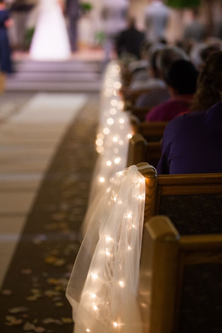 String Lights Covered With White Tulle Decorated The Pews Inside Church Where Ceremony Took