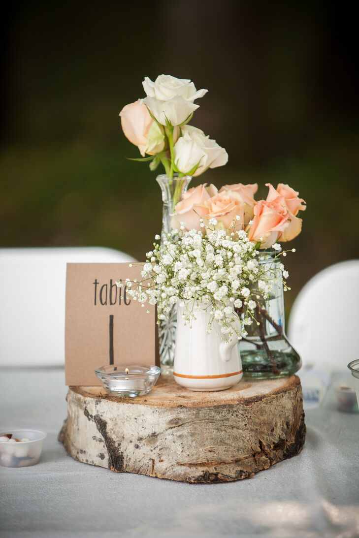 Flower and Table Number on Wood Slab