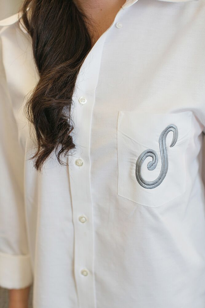 Each bridesmaid wore a custom-monogrammed white dress shirt during hair and makeup preparation before the ceremony.