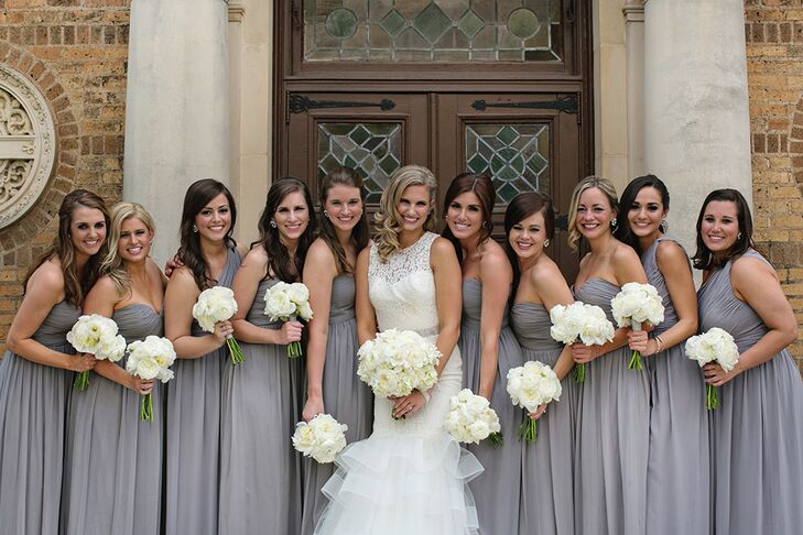 With 10 bridesmaids and three house party, Paige wanted to provide two options and let her party choose which dress fit the most comfortably. Both were heather grey: one was strapless and the other was one-shoulder. Along with their dress, Paige gave each bridesmaid large retro-style J.Crew studs to wear.