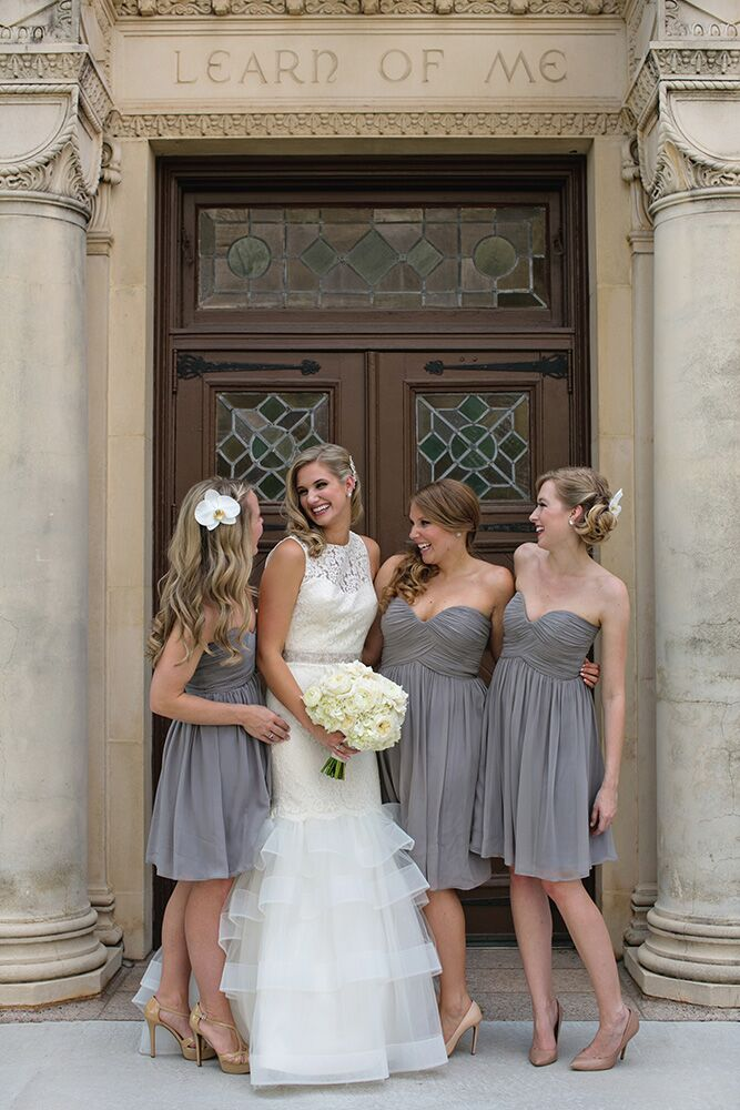 The house party wore a shorter version of the heather grey strapless bridesmaid dress. They also had white orchids in their hair to match the bridal party all-white bouquets.