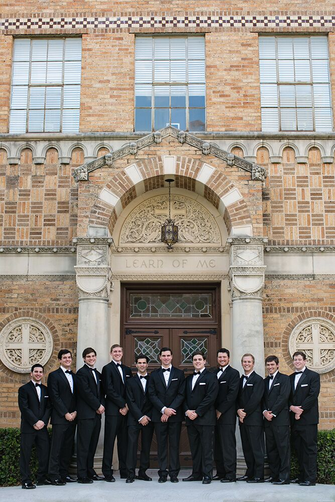All groomsmen wore a black Calvin Klein tuxedo with no cummerbund and a black bow tie to match the groom, complete with a white pocket square to compliment the bridal party's all-white flowers.
