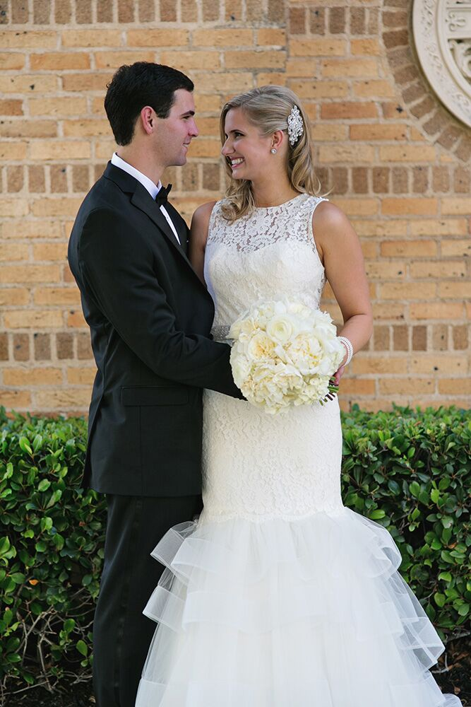 Paige and John share a happy moment outside Central Christian Church in Austin.
