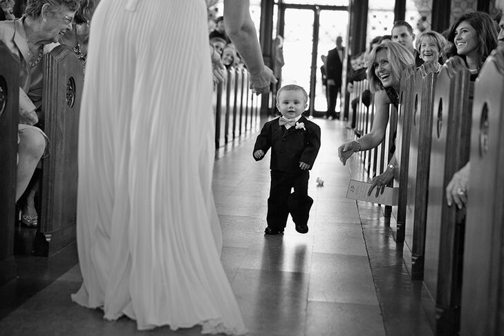 "It was special to the bride to have all the family involved in the wedding, so she wanted her nephew to be the ring bearer. ""He actually only learned to walk one week before the wedding, so his trip down the aisle was a little all over the place, but he made it and looked so cute doing it!"""