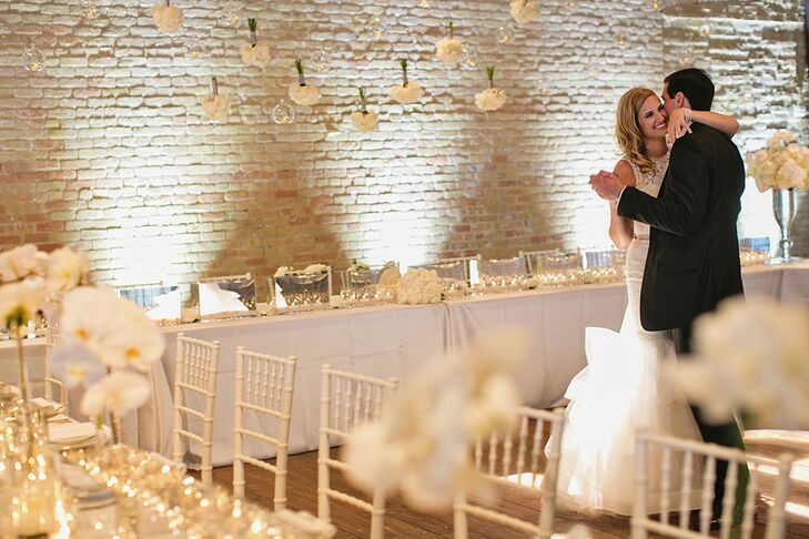 "Paige was set on having a fairytale white tent wedding on a lawn, but as she toured Austin looking for the perfect reception venue, she realized her childhood dream had changed. ""John and I are city people that love great food, urban designs and modern decor. Brazos Hall sat right in the middle of downtown with modern architecture and a rooftop terrace. It was perfect!"""