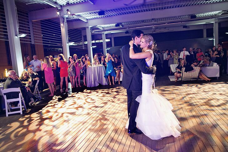 "The bride and groom were touched by lyrics of John Legend's ""Stay with You,"" so they chose this song for their first dance. John and Paige have very different tastes in music, so they were excited to find a song they both agreed upon for their first dance."