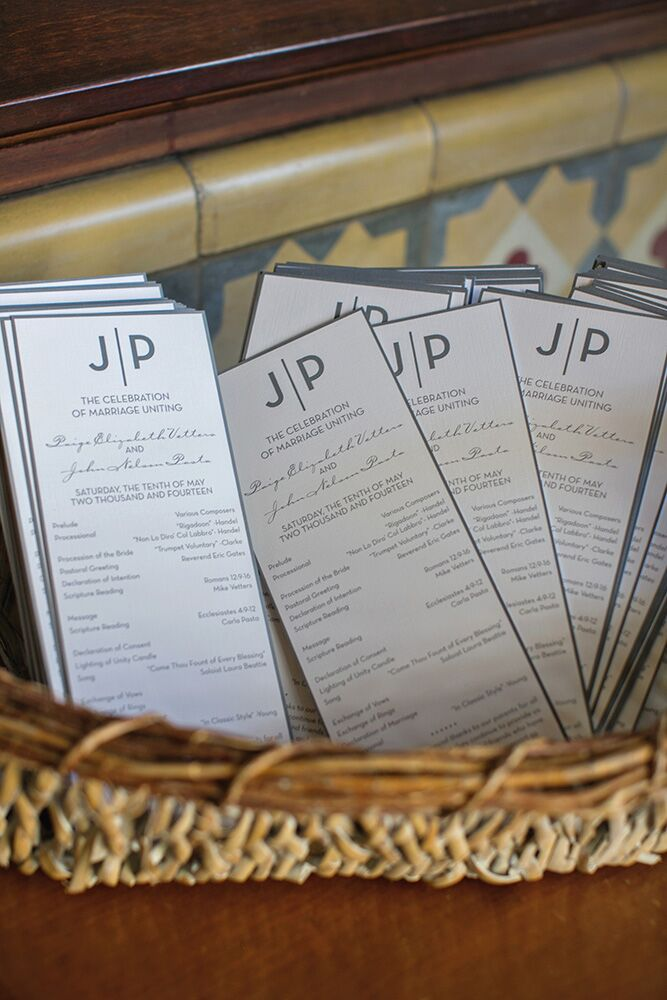 To carry out the celebration's modern theme in the stationery, the ceremony programs featured a JP logo to match the invitations.