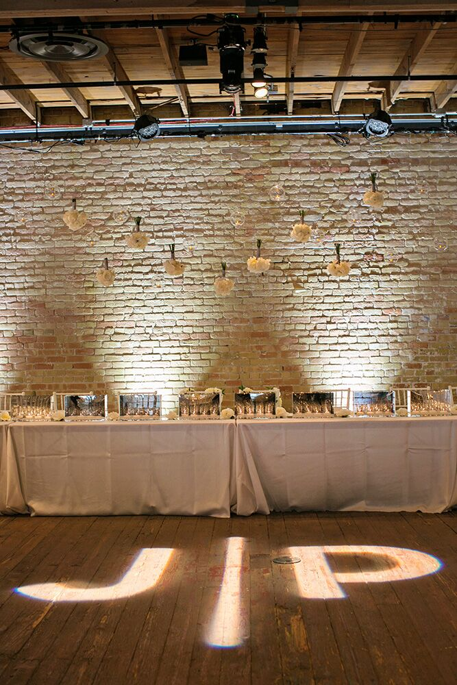 The couple's custom JP logo was projected onto the dance floor in front of the Head Table.