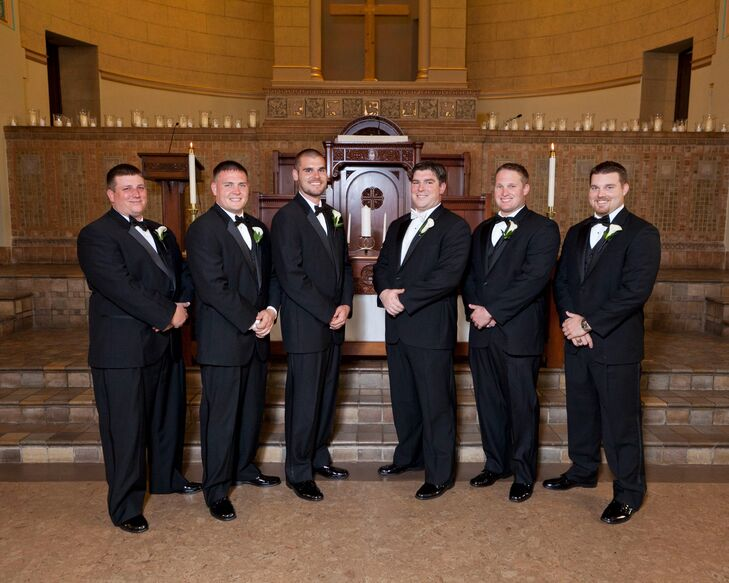 The groomsmen all wore classic black tuxedos with white vests and black bow ties.