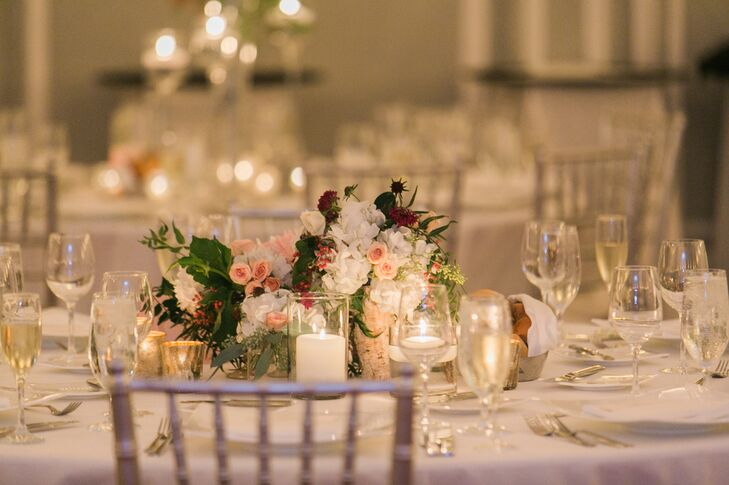 A low arrangement pink roses, white hydrangea and assorted greens decorated the tables. A ring of candles around the floral arrangement added a sophisticated, romantic touch.
